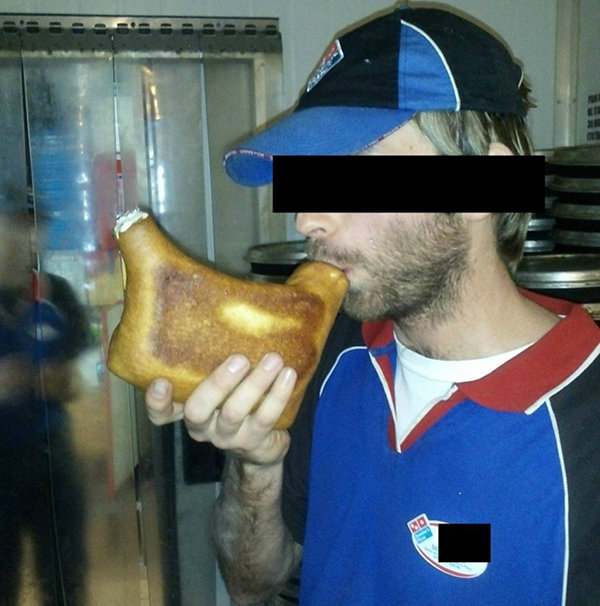 Dominos employee smoking out of a pizza bong.